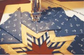 Easy Folded Star Hot Pad Pattern — PlumEasy & You can machine sew the entire project after you position the points. You  can sew the hot pad easily by opening the flaps of the top layer of the  triangle ... Adamdwight.com