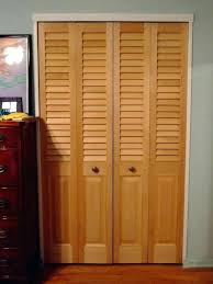 custom size closet doors sized with fixed plantation louvers over colonial raised bifold custom closet doors