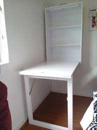 White wall mounted folding desk