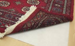 anti slip underlay underneath a red patterned rug