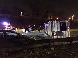 Pickup truck pulling camper trailer flips on side after accident ...