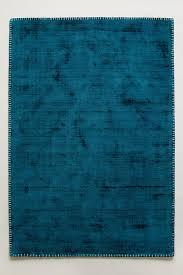 dark turquoise whipstitch rug