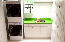 Washer Dryer Cabinet small laundry room design with stacked laundry machines surrounded 3105 by uwakikaiketsu.us