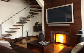 flat screen tv above gas fireplace