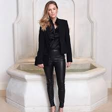 iamdylanpenn wears a black tuxedo silk blouse and leather leggings at ralph lauren s beverly