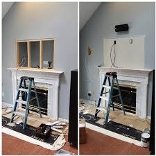 before samsung plasma tv wall mounted above fireplace boston acoustic in wall speakers mounted to the left and right of the tv