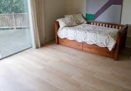New tile floors for guest room - porcelain tile hardwood look contemporary- bedroom