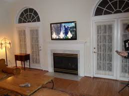 mounting tv above fireplace awesome find this pin and more on diy in hanging tv above fireplace plan