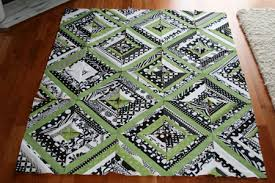 FITF: a black, white and green baby string quilt | Film in the Fridge & It's not yet fully sewn together, and I'm finding that the hardest part of  this quilt might just be removing the freezer paper! It seems as though the  most ... Adamdwight.com