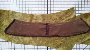 laying the collar onto the lining material to cut out a collar lining