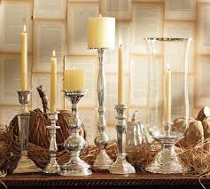 ... Grouping candles of different sizes together makes an interesting  display