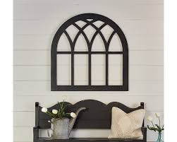 architectural antiques make great wall décor and we found this gothic style cathedral window frame we knew it would work great as an eclectic piece of art