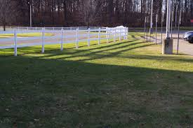 white fence and grass for dog potty area outside main door at msu livestock pavilion