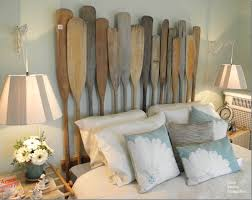 7. A Nautical Headboard with Vintage Oars