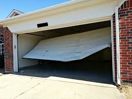 garage door off trackGarage Door Problems  Cowtown Garage Door Blog