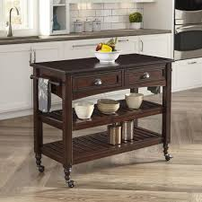 home styles country comfort aged bourbon kitchen cart with stainless steel top 5522 9502 the home depot