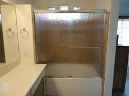 Irvine Soaking Tub With Rain Glass Shower Doors & Recessed Shampoo Shelf  mediterranean-bathroom