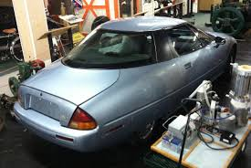 road trip outtakes 1997 gm ev1 who put the electric car in the the ev1 story is fascinating and as i m currently on slow interwebs access i ll give you a couple links to follow for your own further edification and