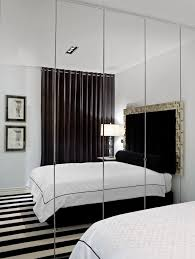 ideas to make a small bedroom feel and look bigger bedroom mirrored cabinets