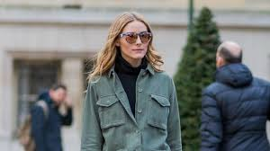 paris france march 07 olivia palermo wearing a green jacket and black leather pants outside giambattista