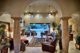 big room large openings rounded corners and stone fire places mediterranean living big living rooms