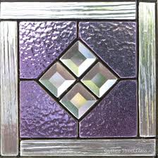 vast geometric stained glass pattern stained glass panel with bevels in the center f6394490