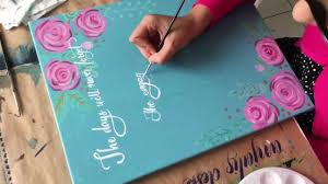brush lettering on canvas hand