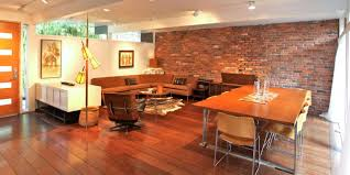 loft modern eliving room exposed brick wall black white red interior design large art furniture sofa