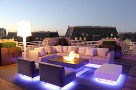 get the cool look of an outdoor miami lounge with patio furniture that s actually lit on the underside the cool purple tones make the ground glow and the