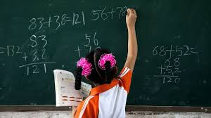 this is your brain on math experts scan the minds of a student writes out a problem on the chalkboard during math class at a school in
