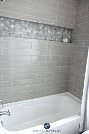 bathroom with bathtub and gray subway tile shower surround niche or alcove in hexagon marble look marble look floor tiles subway