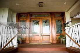 fl glass paned front door with doormat stock photo