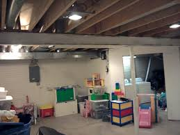 unfinished basement ideas. Basement Lighting For Unfinished Ideas Have Kitchen Equipment Safe In With Brick Wall Design And Decoration O