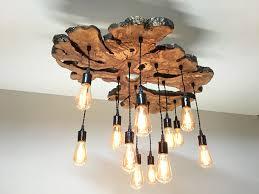 living edge lighting. Wood Lighting. Handmade Extra Large Live-edge Olive Chandelier. Rustic And Industrial Living Edge Lighting