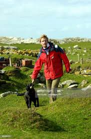 Castaway Benjamin Fogle takes his dog for a walk on the island of ...