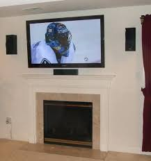 fireplace install tv above brick fireplace over wiring stone wall mount hide wires cables mounting plaster