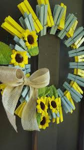 This wreath is made with painted clothes pins, mustard yellow and grey,  little garnishes of sunflowers, perfect for your door! Size - 14 radius  Shipping in ...