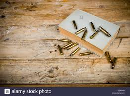 still life with old book and bullets a mystery novel concept