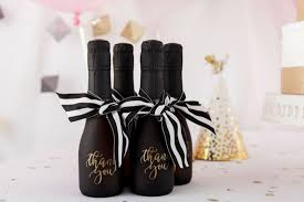 thank your bridal party with these champagne bottle favors