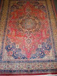 sabzevar rugs are normally cotton based with a thin tightly knotted wool pile similar to close lying mashad in design but with a curvilinear pattern and