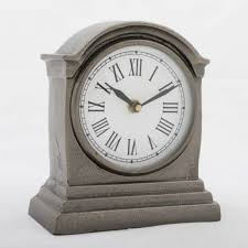 hutt small table clock with round white face black numerals and arms and black nickel finish