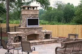 outdoor wood fireplace stones