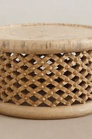 If this is the situation, the table needs being large enough to support snacks. Anthropologie Lattice Drum Coffee Table Copycatchic