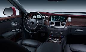 rolls royce ghost 2015 wallpaper. thick seats deep carpets and a chrome wood dashboard cosset driver passengers in an aura of hush calm rolls royce ghost 2015 wallpaper