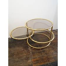 mid century 3 tiered brass and glass swivel coffee table 1980s