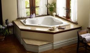 corner bathtubs for two. corner jacuzzi tub with white curtains round table rattan chair and decorative plants: full bathtubs for two o