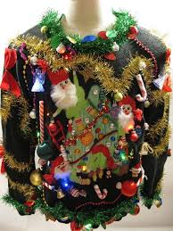 This is the craziest decoration of tacky Christmas sweaters. Adorned with  all the stuff lying in your junkyard, it is perfect to define the concept  of ugly ...