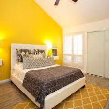 Contemporary Bedroom With Bright Yellow Accent Wall