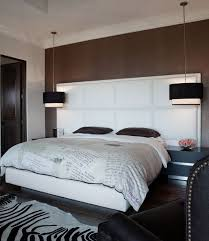 view in gallery black drum pendants create a clear visual focal point in the bedroom