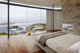 ... Stone Wall In The Contemporary Bedroom Complements The Rugged Landscape  Outside [From: Fulcrum Structural